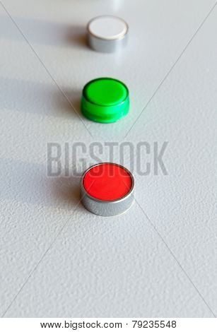 Three Industrial Buttons In A Row