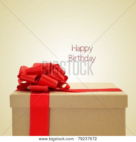 a gift box with a red ribbon bow, and the sentence happy birthday on a beige background, with a retro effect