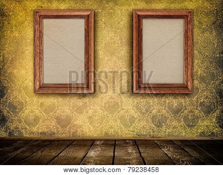 Two Wooden Frames On Wall.
