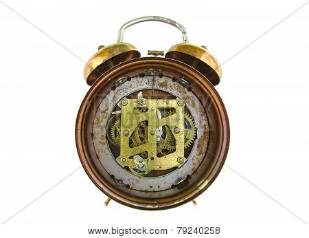 Inside mechanism of old alarm clock isolated on white background