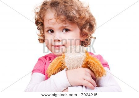 Little Girl Hugging Toy Dog