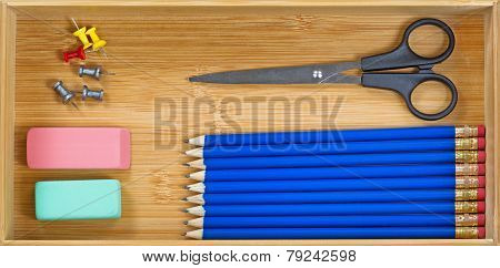 Simple Office Supplies Inside Of Wooden Desk Drawer