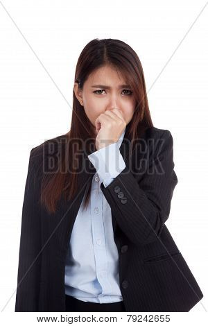 Young Asian Businesswoman Holding Her Nose Because Of A Bad Smell