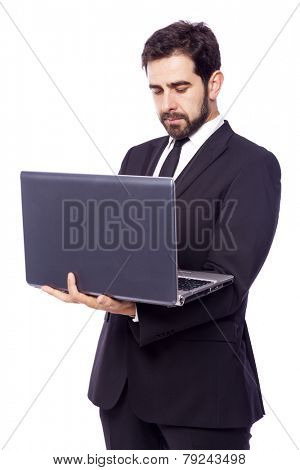 Business man holding a laptop computer, isolated on a white background