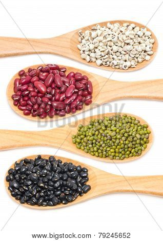 Job's tears, Kidney beans, Mung beans and Black beans with wooden spoon isolated on white.