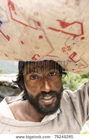 Indian Man Carrying Big Bag On His Head