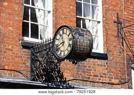 Old clock in iron frame, Tewkesbury.