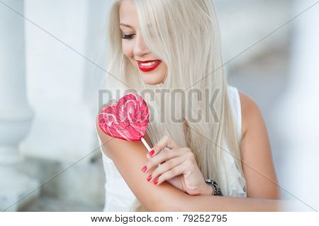 The bright blonde with sugar candy in the form of heart.
