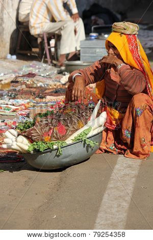 Old Indian Woman Selling Vegetables