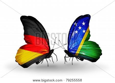 Two Butterflies With Flags On Wings As Symbol Of Relations Germany And Solomon Islands