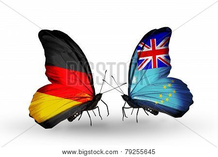 Two butterflies with flags on wings as symbol of relations Germany and Tuvalu
