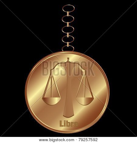 Bronze Charm For Libra Over a Black Background