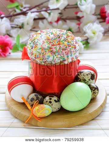 Easter cake with glace icing and colored easter eggs rustic style