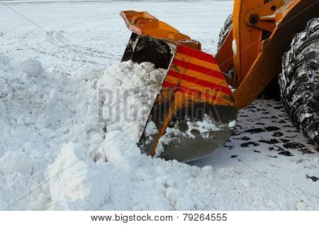 Clearing the road from snow.
