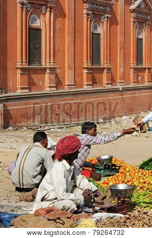 Three Indian Men Selling Vegetables