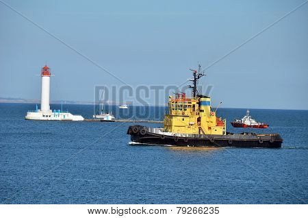 Tugboat over lighthouse