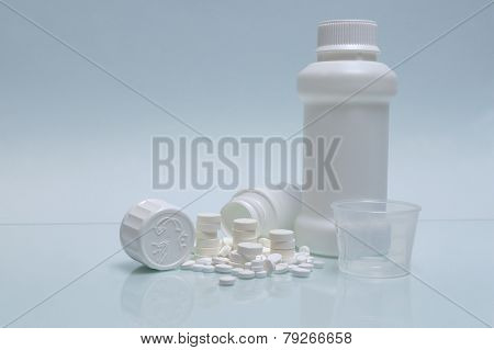 White Tablets, White Pill Container, White Container For Mixture And Measuring Cup