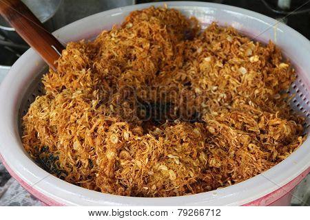Fried shredded pork in process