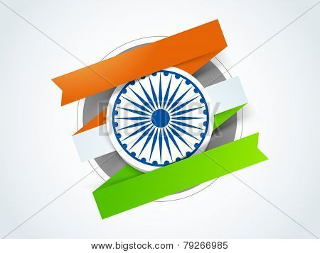 Shiny Ashoka Wheel with national tricolor paper stripes for Indian Republic Day celebration.