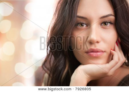 Portrait Of Attractive Brunette Girl With Lights