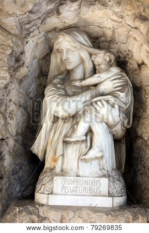 ZAGREB, CROATIA - APRIL 29: Madonna with Child, detail of a mourning sculpture on a Mirogoj cemetery in Zagreb, Croatia on April 29, 2012.