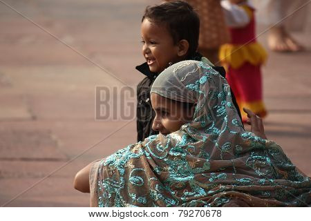 Indian Girl From The Backside, With Her Child