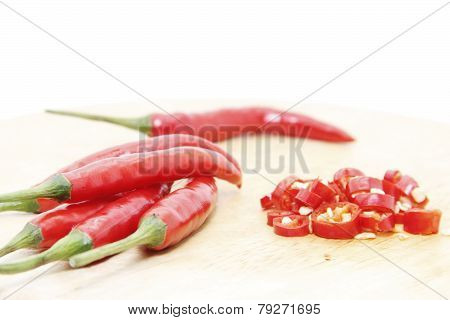 Red Cayenne Peppers Sliced On Board