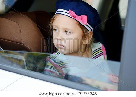 Girl Looking In Car Window