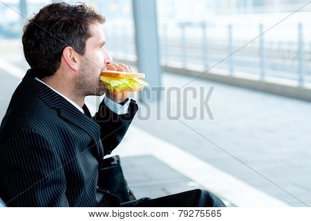 Businessman On Trip Has A Break