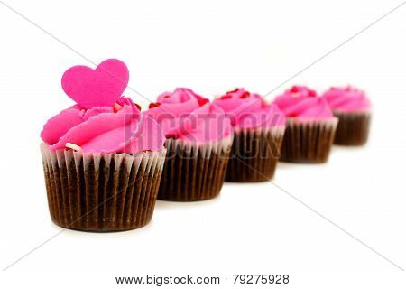 Group of pink Valentines Day cupcakes