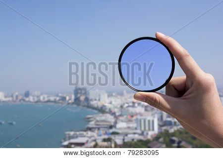 Hand Is Holding Filter Lens