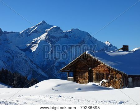 Snow Covered Oldenhorn And Facade Of A Old Farmhouse