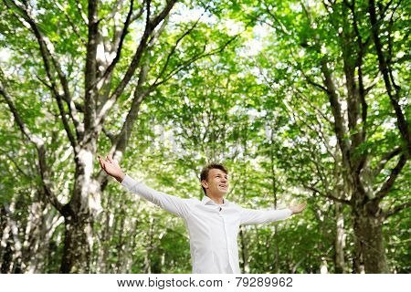 Young Free Man Enjoying Nature - Freedom Happines Concept