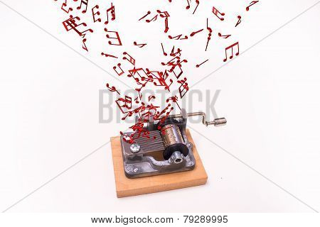 music notes flying out of music box