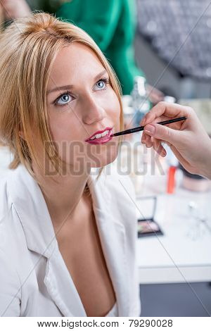 Artist Putting Lipstick