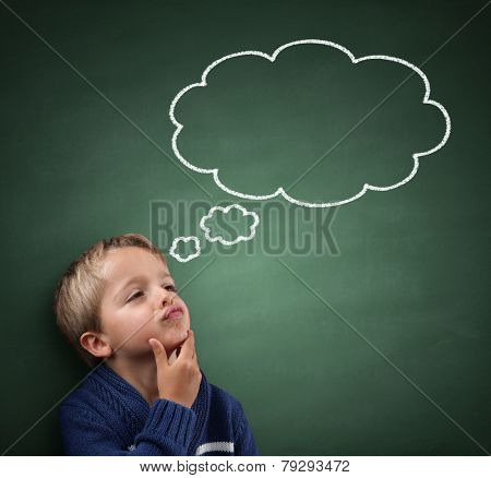 Child thinking with a thought bubble on the blackboard concept for confusion, inspiration and solution