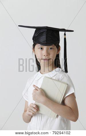 chinese girl wearing a mortar board