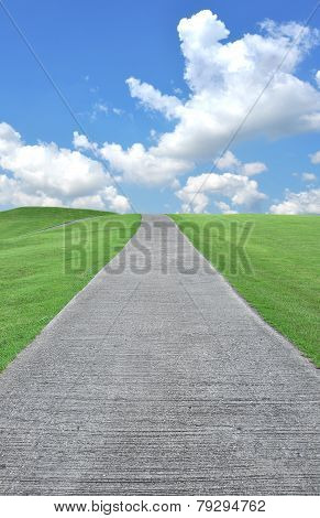 Pathway In Park On Fresh Grass And Beautiful Blue Sky