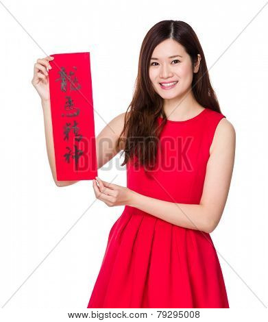 Asian woman hold with china Fai Chun, phrase meaning is blessing for good health