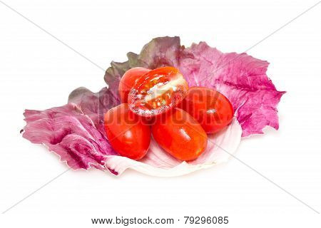 Cherry Tomatoes With Radicchio Leaf Isolated On White.