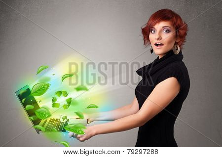 Casual young woman holding notebook with recycle and environmental symbols