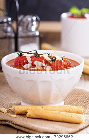 Tomato soup garnished with baked tomatoes