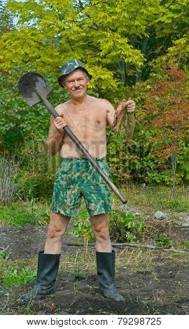 Man With Spade And Carrot