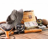 stock photo of fly rod  - Assortment of fly fishing equipment on white background - JPG