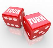 picture of dice  - Your Turn words on two red dice to illustrate the next move in a game - JPG