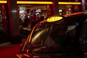 picture of cabs  - Low key detail of London black cab sign turned on at night - JPG
