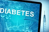 foto of diabetes  - the word diabetes on a tablet with syringe - JPG