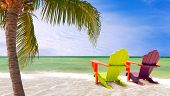 picture of summer beach  - Panorama of colorful lounge chairs at a tropical paradise beach in Miami Florida - JPG