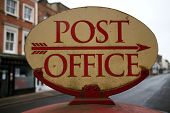 picture of old post office  - Vintage Post Office sign in the high street of a town with an arrow pointing in the right direction - JPG