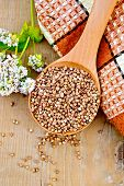 stock photo of buckwheat  - Buckwheat in a spoon with flower buckwheat - JPG